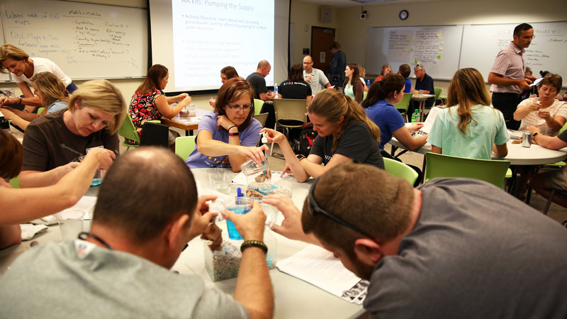 Water educators practice using groundwater kits