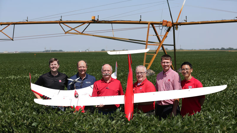 UAV research team standing in field